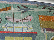 Mural highlight number one shows airplanes and an air traffic control tower