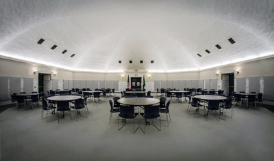 Click to see a large version of the Columbia Room set up with round tables for an event