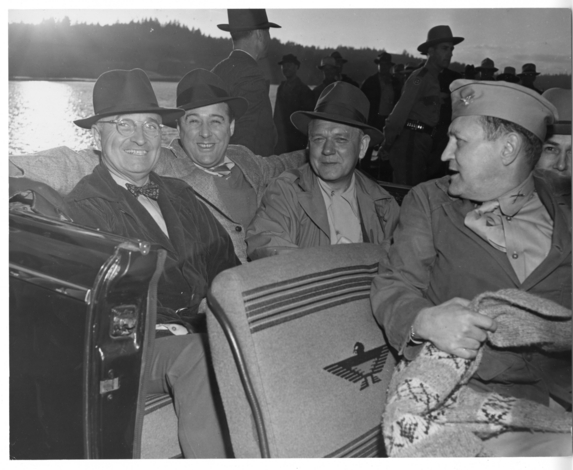 President Harry S. Truman goes for a car ride near Olympia.