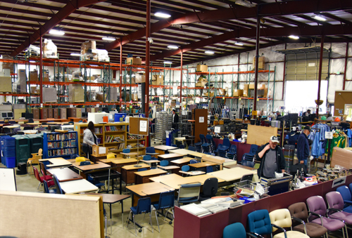 Inside the Surplus retail store, with furniture, electronics and other items.